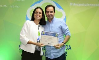 Expresso Santa Cruz recebendo o certificado de Empresa 100%